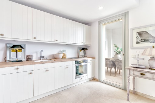 The tastefully designed kitchen has access to the terrace