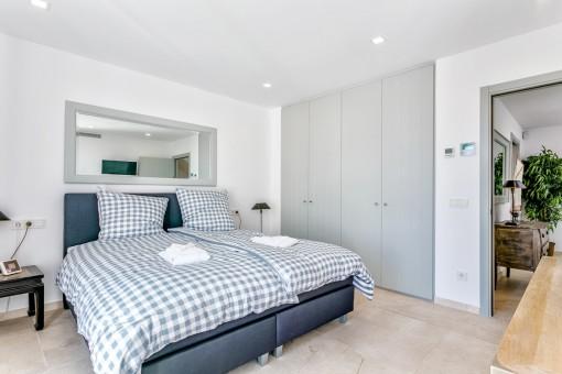 This cosy bedroom has a built-in wardrobe