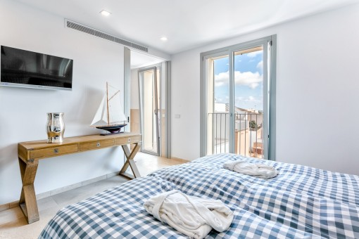 Double bedroom flooded with natural light