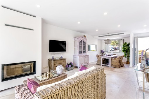 Spacious living and dining area with fireplace