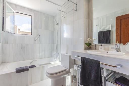 Bathroom with bathtub and window