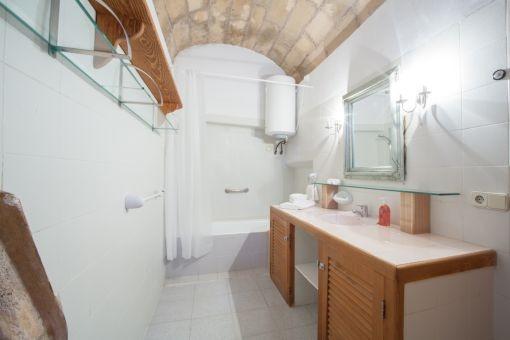 Bathroom with bathtub and vault