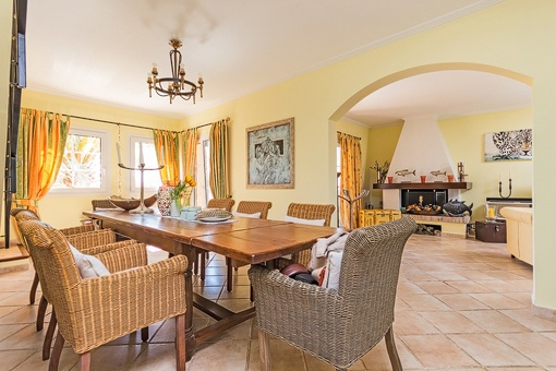 Bright dining area beside living room