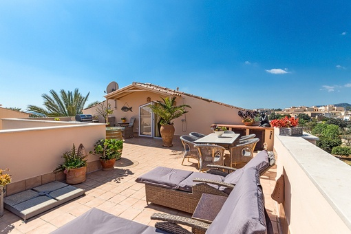 Sunny roof terrace with seating area