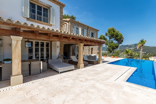 Views to the covered terrace from the pool area