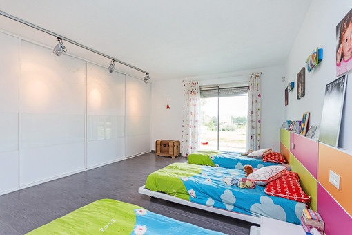 Spacious bedroom with built-in wardrobe