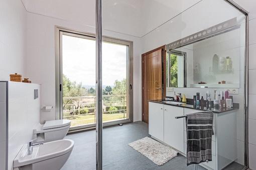 Master bathroom with large windows