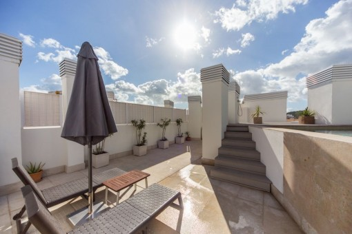 Sunny roof terrace with relaxing area