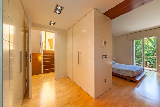 Master bedroom with built-in wardrobes