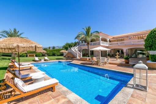 Sunny pool area surrounded by terraces