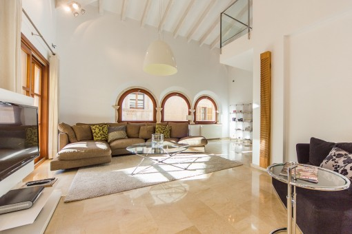 Cosy living area with original arched windows