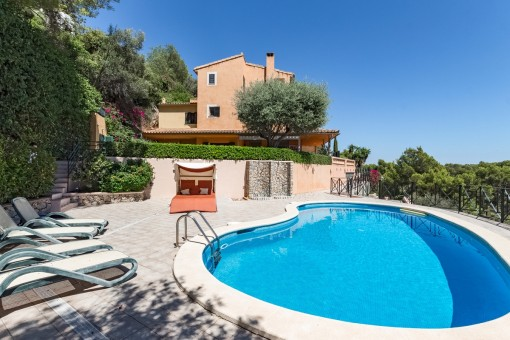 Beautiful community pool with sun loungers
