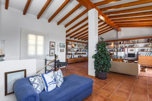 Spacious loft with wooden ceiling beams
