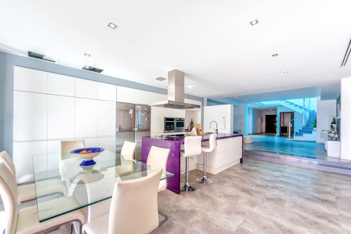 Open living and dining area with integrated kitchen