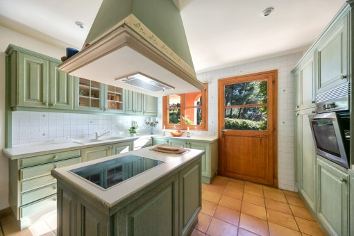 Kitchen with cooking island and utility room