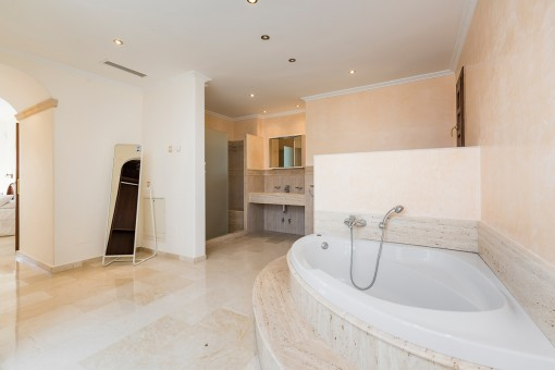 Large bathroom with bathtub and shower