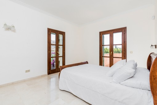 Bright bedroom with terrace access