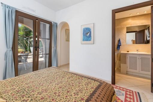 Inviting bedroom with bathroom en suite