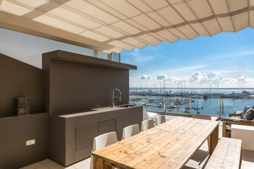 Dining area with outdoor kitchen on the roof terrace