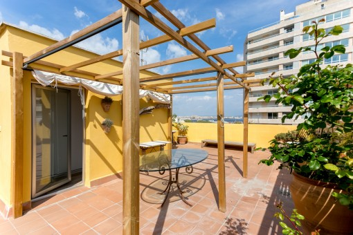 Modern loft apartment with large roof terrace, partial sea views and parking space in Palma-Porto Pi
